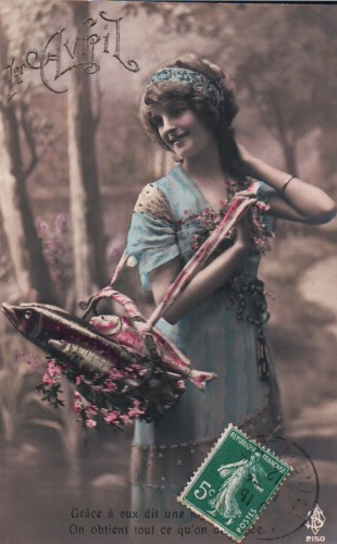 A woman with a basket full of chocolate fish      (postmarked 1912)