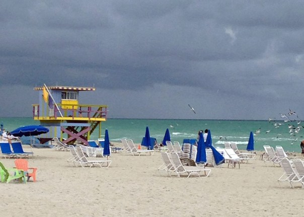 Resort hotels have (attended) chairs and umbrellas along the beach reserved for their guests.  If you plan to lounge on the beach and will need shade, bring your own.