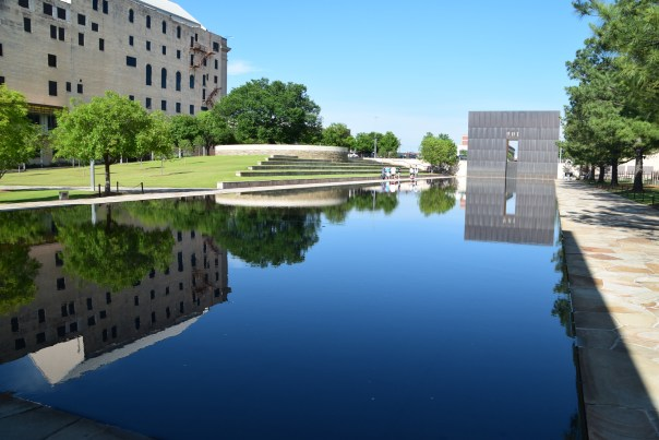 "At the Oklahoma City National Memorial, two large ""walls"" frame the reflecting pool.  The one shown here says 9:01 and it's twin, 9:03.  the bomb was at 9:02, at the location of the pool."