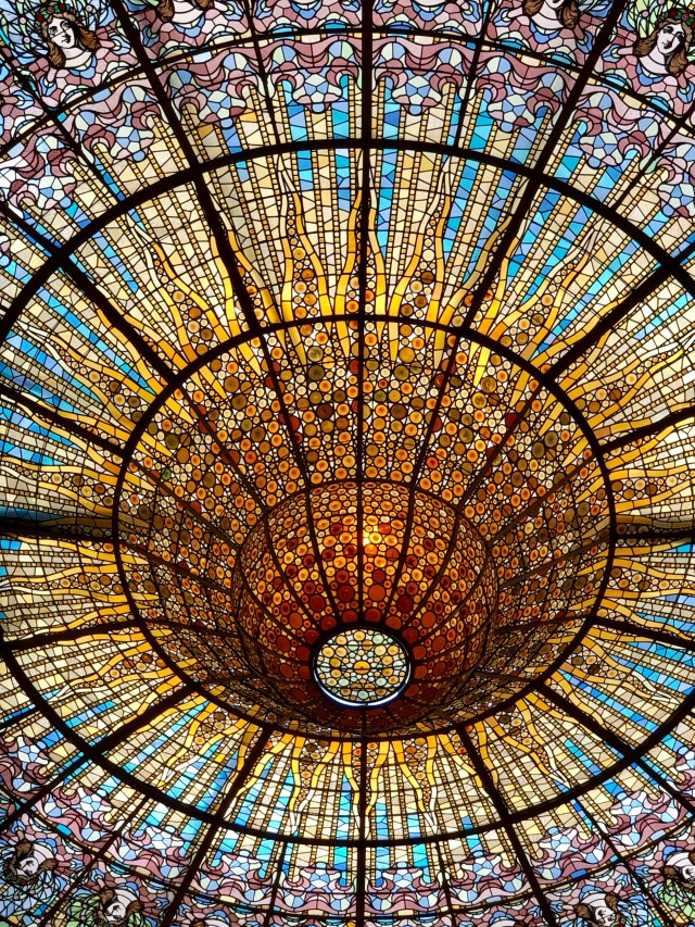 Stained glass ceiling at Barcelona's iconic El Palau de la Música Catalana.