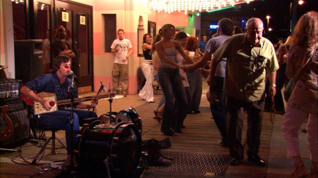 """Richard Johnston performing on Beale Street as seen in """"Richard Johnston: Hill Country Troubadour,"""" a documentary shot in 2004 and 2005.  Please note: Johnston no longer performs on Beale Street."""