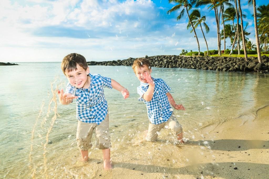 boys in ocean hawaii