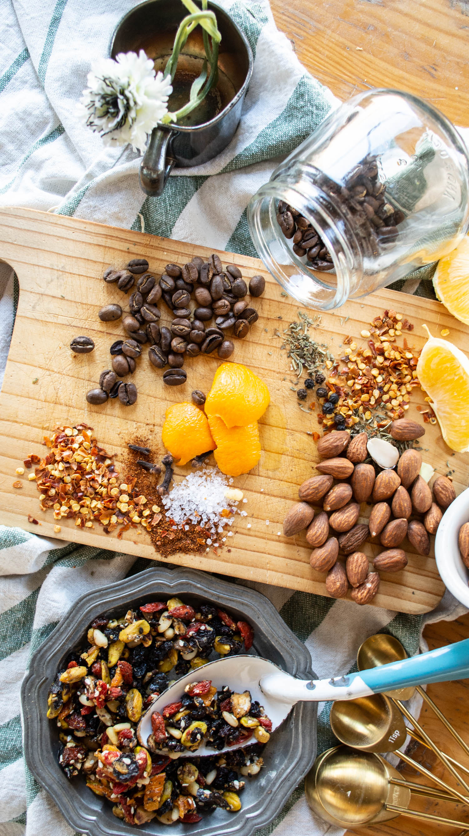 Trail mix raw ingredients arranged on a wooden chopping block. food photography