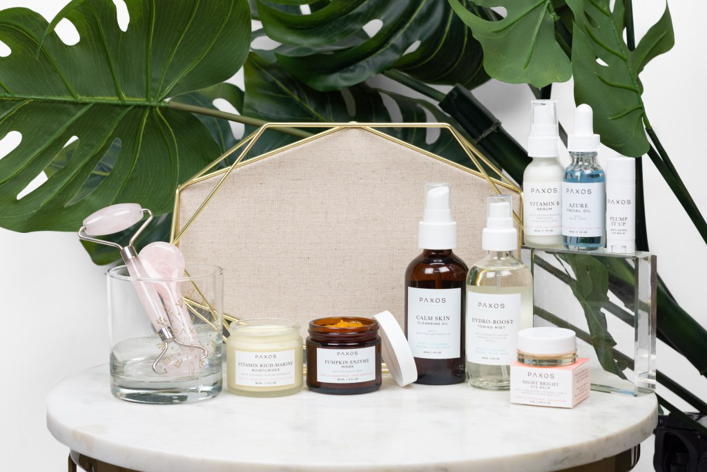 Skincare group shot on marble table with greenery background