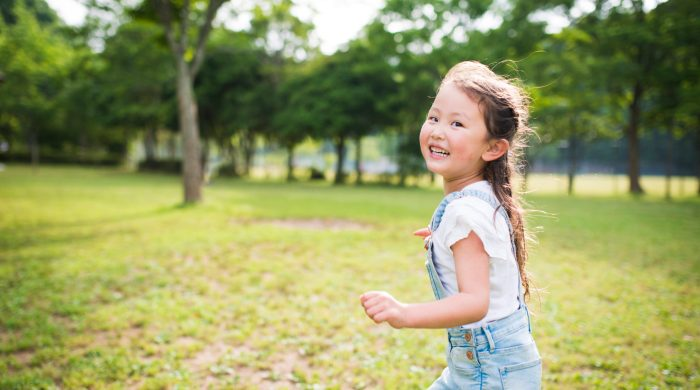 Outdoor literacy games - little girl running outside