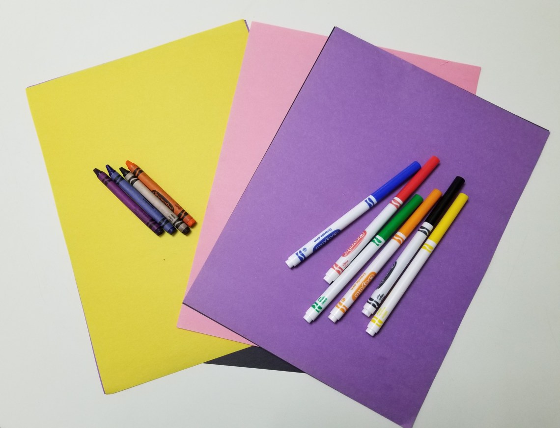 sheets of colored paper with colored markers
