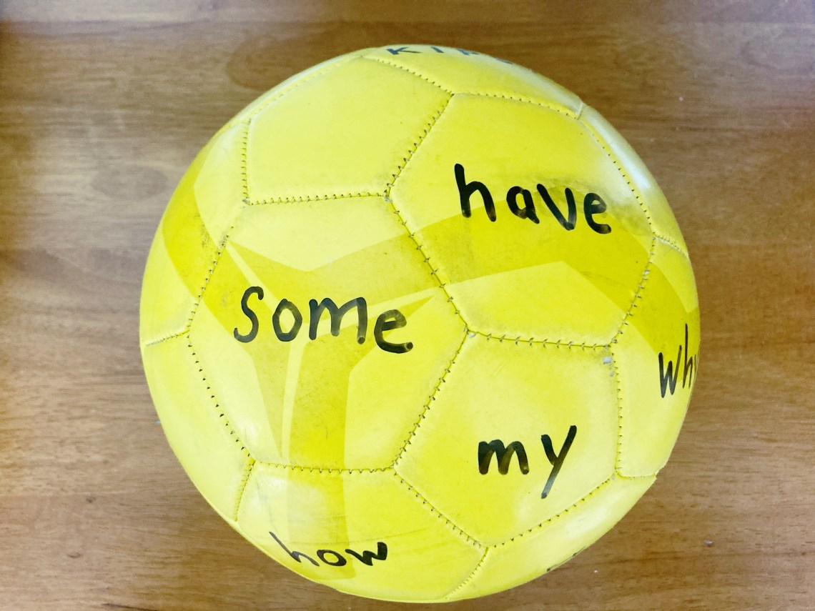 Yellow soccer ball with sight words written on it