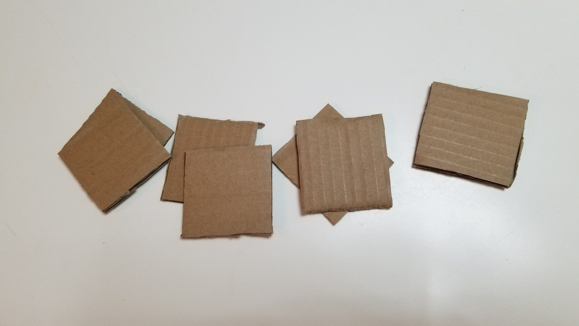 pieces of cardboard cut into squares