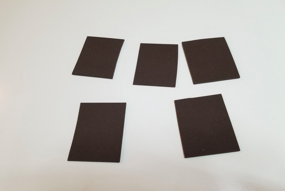 pieces of dark brown construction paper cut into squares