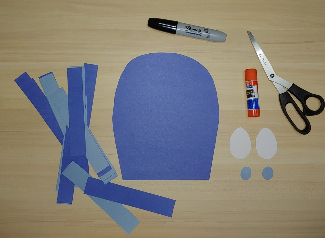 Construction paper, scissors, glue stick, sharpie