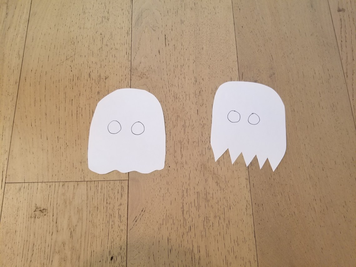 Paper ghosts with 'OO' drawn in the middle of each