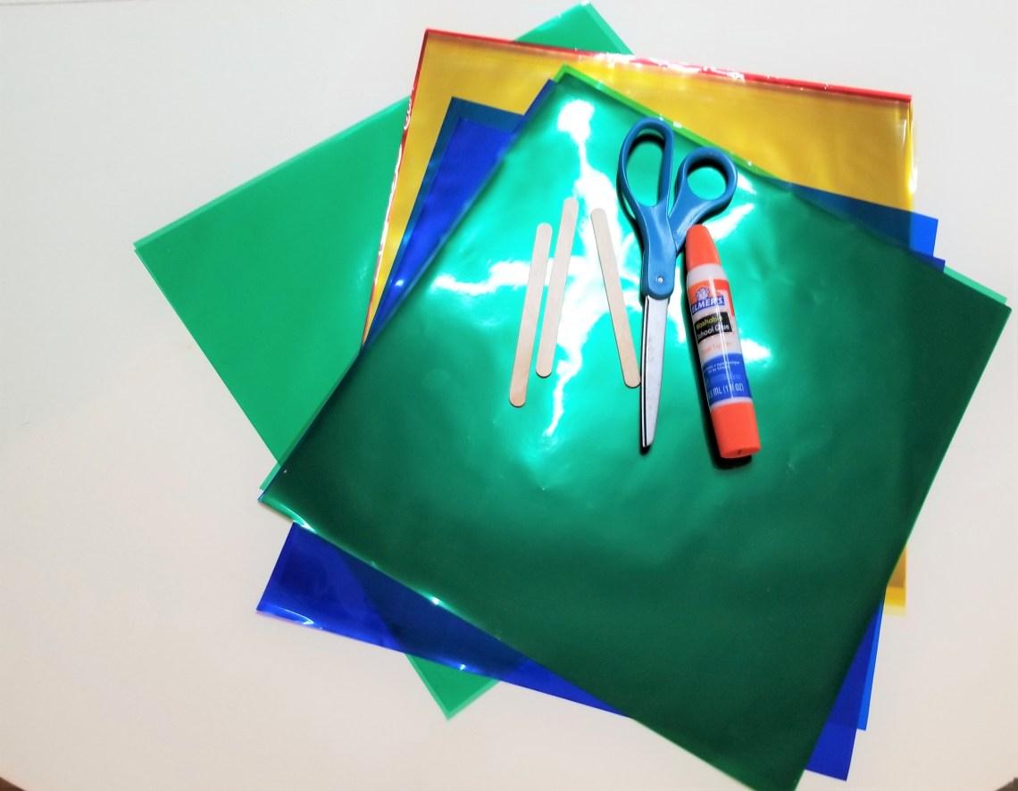 Plastic transparent folders, scissors, glue stick, craft sticks