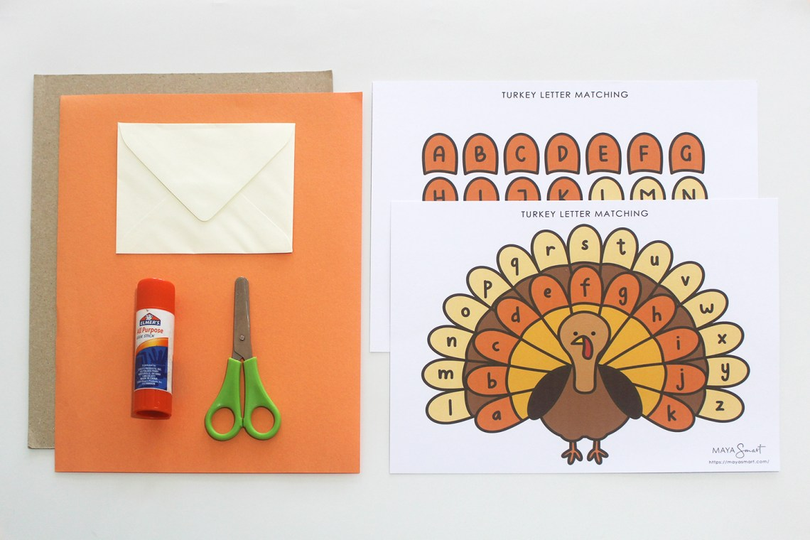 Construction paper, scissors, glue, envelope, turkey letter matching printable