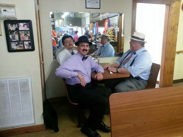 The boys getting a pork chop sandwich at The Snappy Lunch in Mt. Airy, NC.