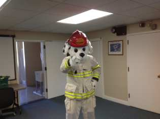 Sparky the fire dog telling kids to be fire safe.