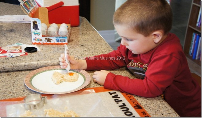 Small Boy Decorating Rice Krispies