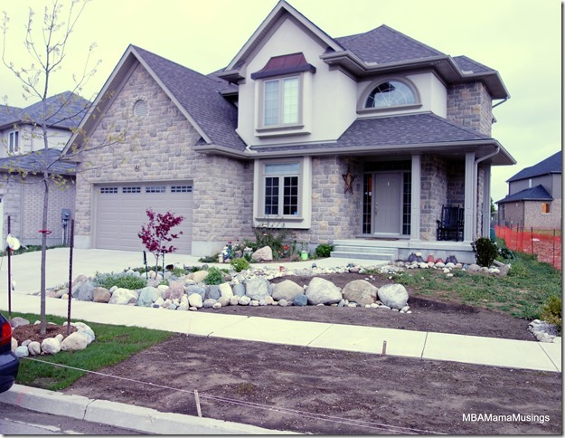 Yard in front of house being landscaped with rocks