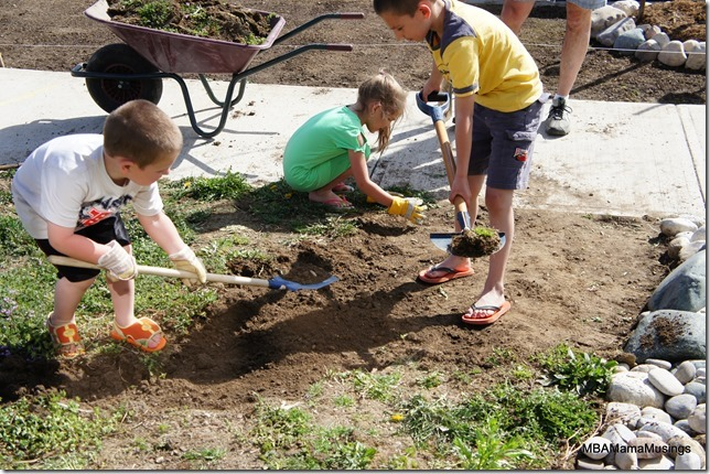Three children removing dirt
