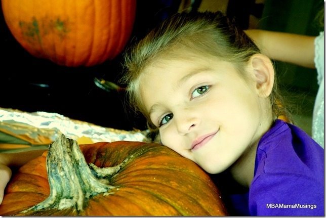 Girl Hugging Halloween Pumpkin
