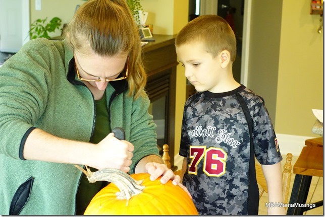 Mom Cutting Pumpkin With Butcher Knife
