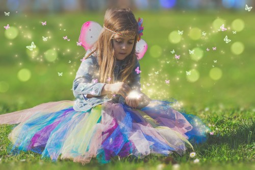 Beautiful little girl with magic butterfly; fantasy concept