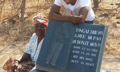 Peter Moyo at fathers grave
