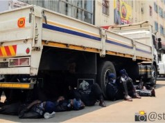 Police under a truck