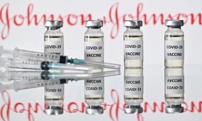 (FILES) This file photo taken on November 17, 2020 in London shows vials with Covid-19 vaccine stickers attached and syringes with the logo of US pharmaceutical company Johnson & Johnson. - Up to 400 million doses of Johnson & Johnson's Covid-19 vaccine will be made available to African countries, the US pharmaceutical giant said on March 29, 2021. The availability of the single-shot vaccine will be subject to national regulatory approvals in the African Union's 55 member states, with the first shipments expected to arrive in the third quarter of 2021. (Photo by JUSTIN TALLIS / AFP)