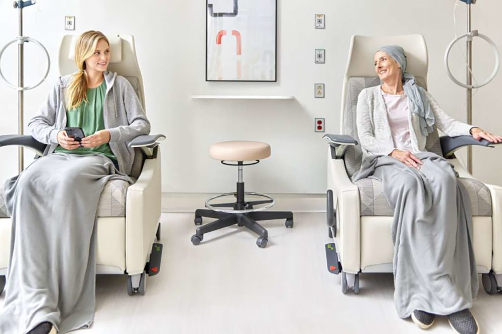 Two ladies in hospital chairs