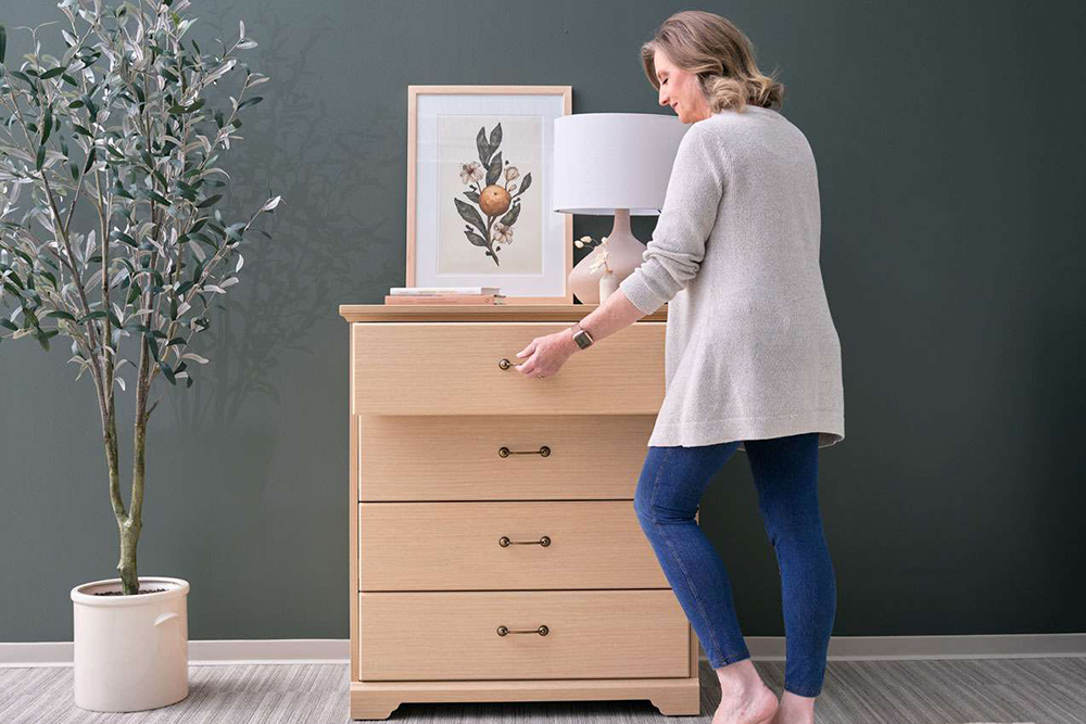 lady opening dresser drawer