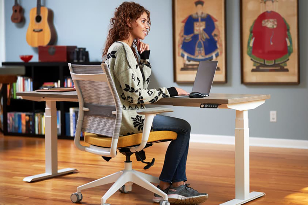 Woman at desk in home office