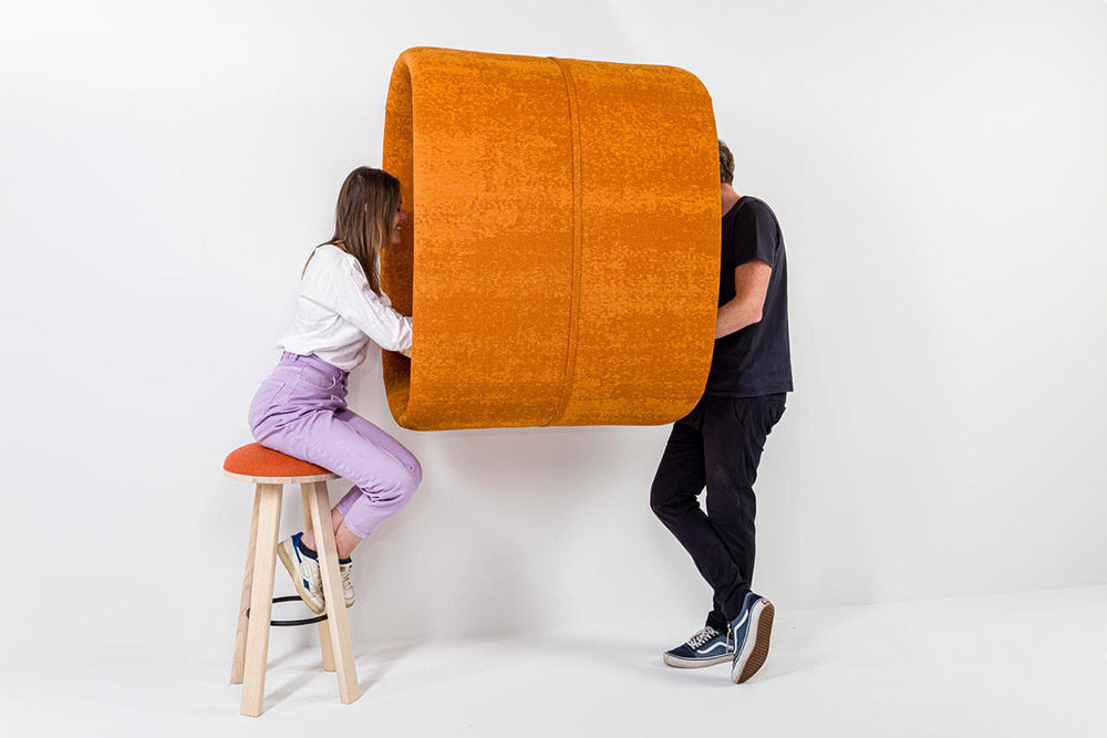 Woman and man conversing in privacy pod