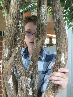 Jacob Boling posing behind the tree of FC's spine.