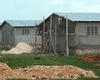 MCC-supported construction of 100 homes (50 duplexes) in Cabaret, Haiti, is projected for completion by late February, allowing about 500 people currently living in tents to have permanent houses.  MCC Photo: Patrick Nelson