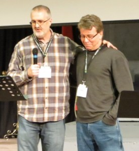 ABMB executive director Daniel Beutler prays for Terry Lamb, who will serve the province in the areas of pastoral care and prayer.