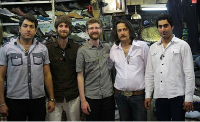 Brothers Jared and Lucas Klassen (middle) with their Iranian shopkeeper hosts. Photo: courtesy Lucas Klassen