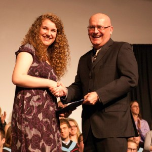 Bethany president Howie Wall congratulates Stephanie Chase, winner of the 2nd-year academic award (for excellence in an exegetical or research paper ) and the Governor General's bronze medal