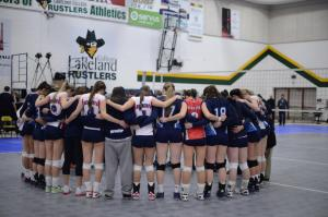 CBC Bearcats pray with an opposing team post-game. Photo: Brin Dyer - Lakeland College