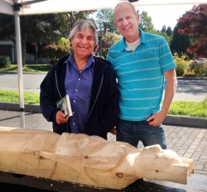 Don (r) with friend and Aboriginal artist Isadore Charters carving a healing totem pole.