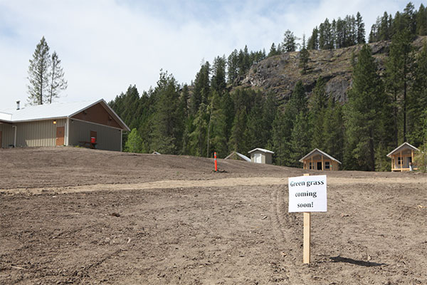 "A sign of hope greets visitors as the Pines camping season nears. It doesn't look like it did before the windstorm, but director Gene Krahn says after all the redesign work, ""it really is beautiful."""