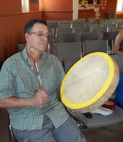 Westview member Ray LaChance plays a  traditional drum in worship. Photo: Stacey Weeks
