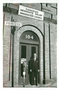 Executive director J.M. Klassen stands outside the first MCC Canada office in a DeFehr warehouse on Princess Street, Winnipeg.
