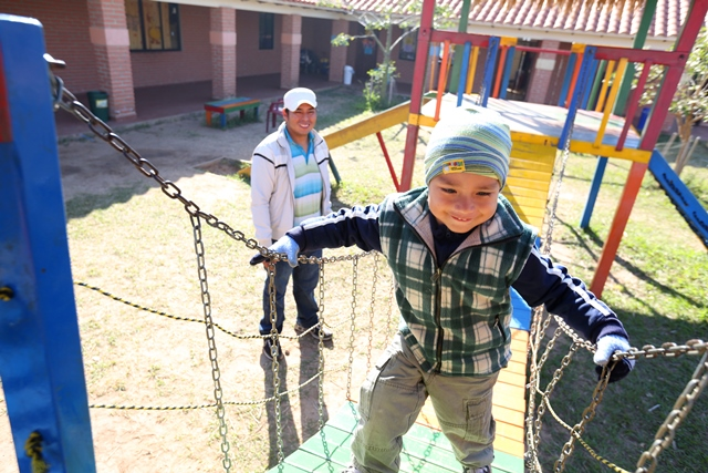 Oscar Yoadel, 4, plays at Guarderia Samuelito, his daycare in Santa Cruz, Bolivia run by the Bolivian Evangelical Mennonite Church, an MCC partner. His father, Oscar Pinto, is a single dad who would not be able to work full-time without the daycare.   MCC photo by Nina Linton