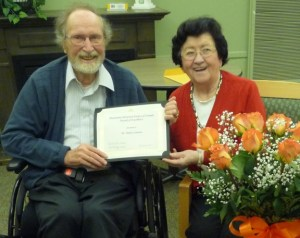 Harry and Gertrude Loewen receive the MHSC Award of Excellence.