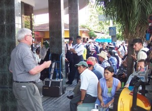 Norman Brown preaching in a market.