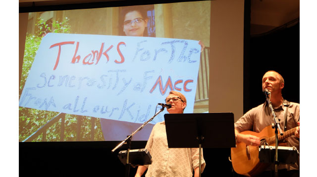 Kim Thiessen and Darryl Neustaedter Barg, pictured in performance at the 2014 annual general meeting of MCC B.C., communicate hope through music. They have collaborated since 2001 to raise awareness and funding toward MCC's HIV/AIDS work, raising more than $800,000 for MCC's Generations Program. Their fifth album is Even in the Smallest Places. Photos: Sophie Tiessen-eigbike