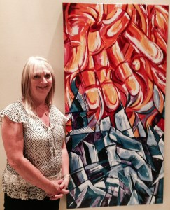 """Winnipeg artist Faye Hall with her Human Rights Showcase painting """"Fire & Ice"""" inspired by Dirk Willems."""
