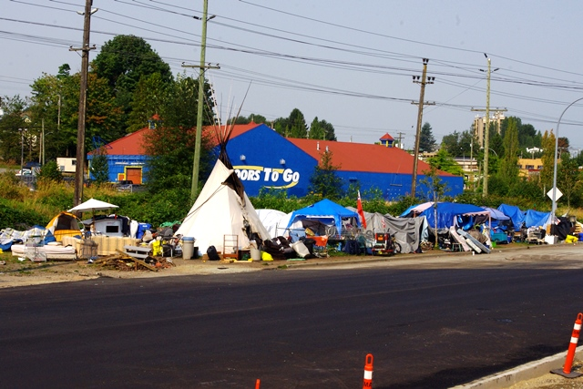 A tent city for homeless people across from the new centre raises questions.