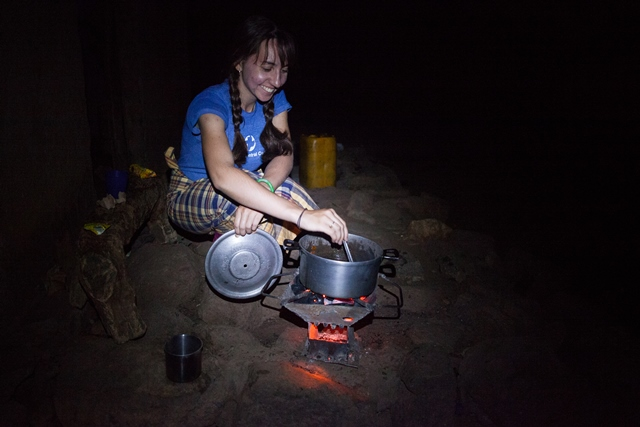 Rebecca Standen prepares her evening meal outside her house in the village of Capinga, near the city of Tete in Mozambique. Standen is an agricultural extensionist with MCC Mozambique. In 2014, she trained and supported community members where new sand dams are built. MCC, in partnership with Christian Council of Mozambique, has built 26 sand dams in the Tete region, between 2008 and 2014. MCC photo by Matthew Sawatzky