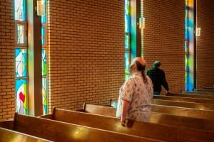 A congregation member contemplates the light.